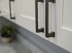about-us-white-cabinets-brass-handles